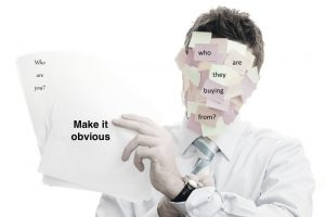 When the obvious isn't obvious. Businessman covered with memos on white background